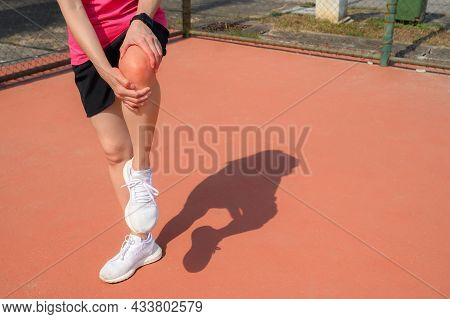 Cropped Shot Of Woman Runner Suffering From Knee Pain. It Often Happens When Your Kneecap Is Out Of