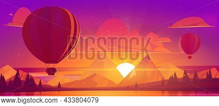 Hot Air Balloons Flying In Sunset Sky Above Water Pond And Mountains In Red And Orange Colored Heave