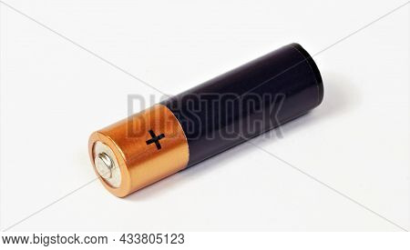 The Battery Is Isolated On A White Background. The Battery Of Electrical Devices.