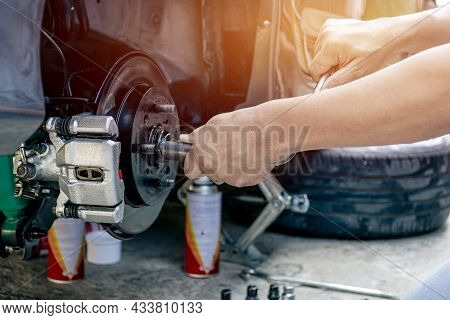 Close Up Hand A Man Repairing And Simple Test Bolt Of Car Wheel After Repair Paint And  Maintenance