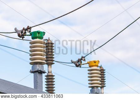 High Voltage Circuit Electric Breaker In A Power Substation.closeup Of High Voltage Insulators At Ne