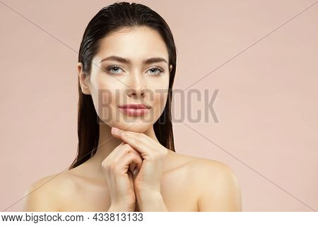 Beauty Face Woman Portrait. Healthy Skin Care And Make Up. Girl With Hands Under Chin With Gloss Mak