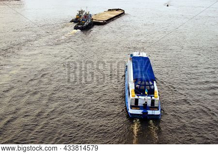 River Traffic On The Dnipro River In Kyiv. A Large Barge With Sand Sails Forward. Touristic River Cr