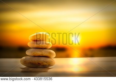 Stack Pyramid Stone Zen Pebbles Nature On Wooden With Blur Sun Set On Sea. Meditation Tranquil Calm