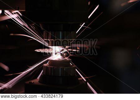 Laser Cutting Of Metal Closeup. Metal Cutting And Laser Sparks