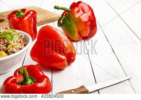 Halloween Fest Food Idea Jack-o'-pepper. Red Peppers Carved Like Jack-o'-lanterns Ready To Stuffed W