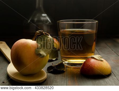 Vegetarian Fruit Composition.a Glass With Apple Cider Vinegar, An Apple With Leaf On Wooden Spoon An