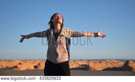 Asian Backpacker Female Tourist Enjoying Nature With Arms Outstretched Eyes Closed