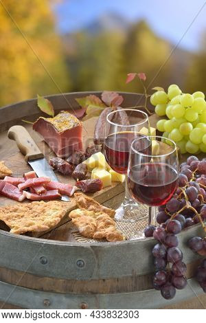Autumn Wine Tasting In South Tyrol With A Hearty Snack Consisting Of Bacon, Salami, Mountain Cheese