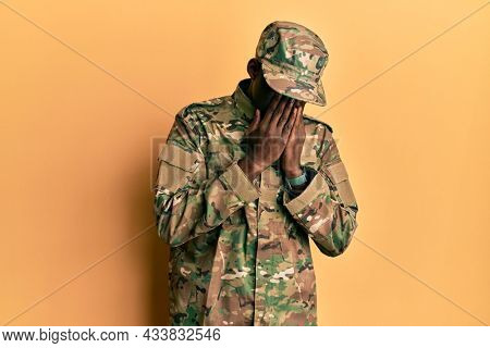 Young african american man wearing army uniform rubbing eyes for fatigue and headache, sleepy and tired expression. vision problem