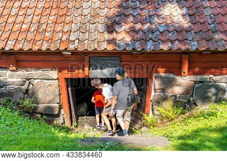 Vira Bruk, Sweden - July 5, 2021: Outdoor Summer View Of Woman And Children Entering The Sixteenth C