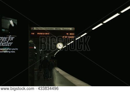 Stockholm, Sweden - August 27, 2021: Perspective Dark Nighttime View Of Signs And Lights On The Subw