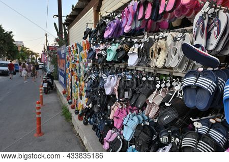 Platanias, Crete - July 21: Summer Flip-flops For Sale On The Wall Of A Souvenir Shop In Platanias,