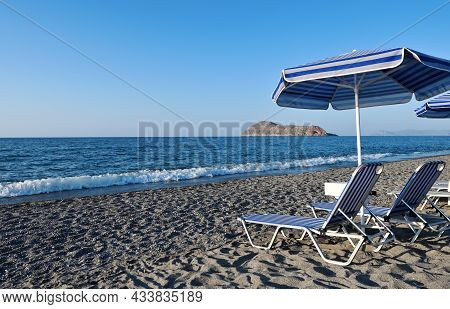 Empty Sunbeds At The Beach Of The Hotel, Crete Island, Greece