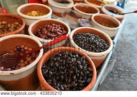 Assortment Colorful Organic Olives At Farmers Street Market Stall In Chania, Greece. Healthy Mediter