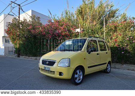 Chania, July 21: Yellow Suzuki Wagon R Parked By The Side Of The Road On July 21, 2021 At Chania, Gr