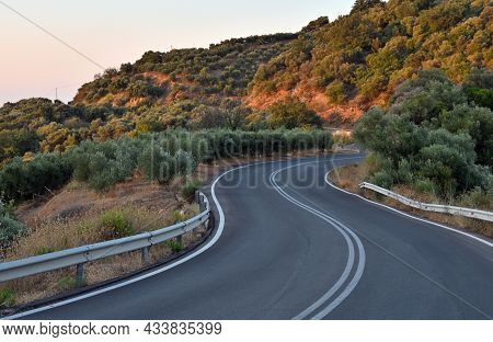 Highway Road In The Mountains, Rocks On Both Sides With Mountains In The Background. Crete Island, G
