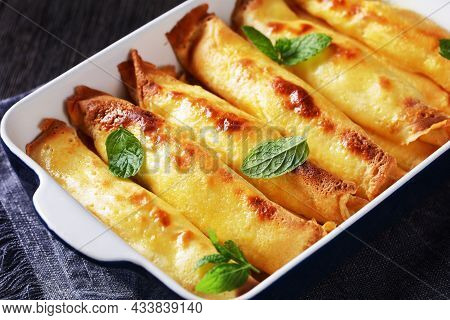 Blintz, Rolled Filled With Sweetened Cottage Cheese Pancakes Or Crepes In A Baking Dish On A Wooden