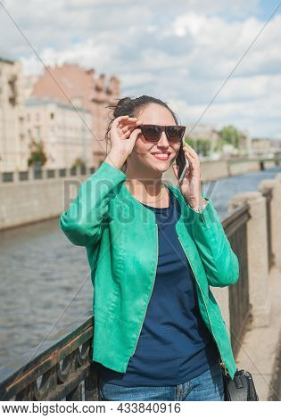 Beautiful Stylish Woman Posing In The City And Talking On Mobile Phone