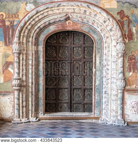 Vintage Metal Door. Old Ancient Antique Doors Inside The Temple, The Walls Are Painted With Frescoes