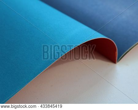 Fragment Of A Set Of Colored Paper On Unfolded Pages Of Blue Color Close-up, Stationery Conceptual B