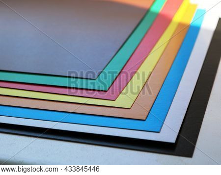 Sheets Of Colored Cardboard Lying On The School Desk, Paper Of Different Colors In The Classic Spect