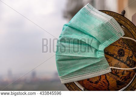 The Globe Is Wearing A Disposable Medical Mask. Concept Of Prevent Spread Of Corona Virus Covid-19.