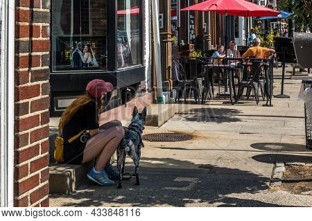 Sleepy Hollow, New York - September 18: A Girl And Her Dog Have A Rest Downtown On September 18 2021