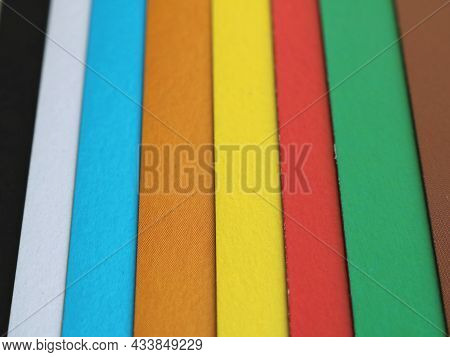 A Spectrum Of Classic Bright Colors Presented In Narrow Paper Stripes, Overlapping Of Colored Sheets