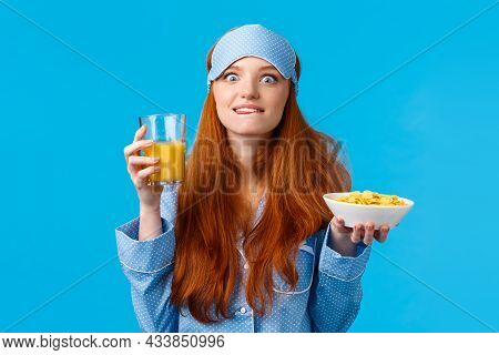 Delicious. Woman Eating Favorite Food In Morning. Cute Redhead College Girl In Sleep Mask And Nightw