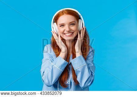 Waist-up Shot Cheerful Pretty Foxy Caucasian Girl Listening Music In Large Headphones, Smiling Pleas
