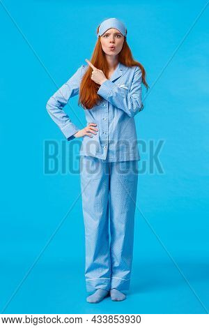 Disappointed And Mad Bossy Redhead Teenage Girl Scolding Roommate Making Huge Noise At Night, Wearin