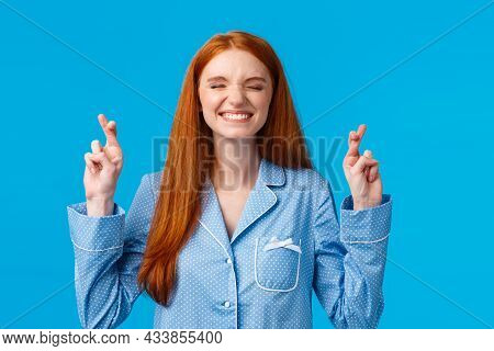 Girl Believes She Must Win. Lucky Cute Redhead Woman With Long Red Hair, Wearing Nightwear, Smiling