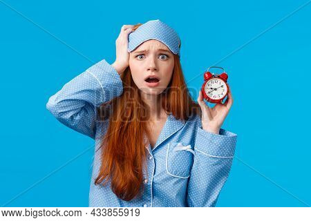 Anxious, Panicking Young Redhead Girl Missed Interview, Overslept, Holding Red Alarm Clock And Touch
