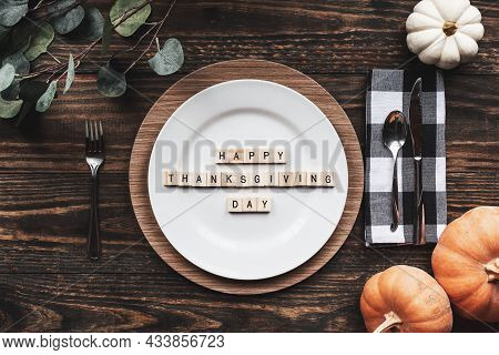 Place Setting With Plate, Napkin, On A  Decorated Table Shot From Flat Lay Or Top View Position. Hap
