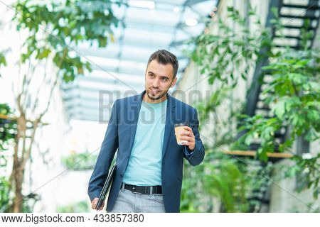 A Young Successful Businessman Is Walking Down The Street. Man In A Casual Wear. Business, Freelance
