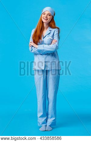 Lifestyle, People Concept. Happy Good-looking Glamour Redhead European Female In Nightwear And Sleep