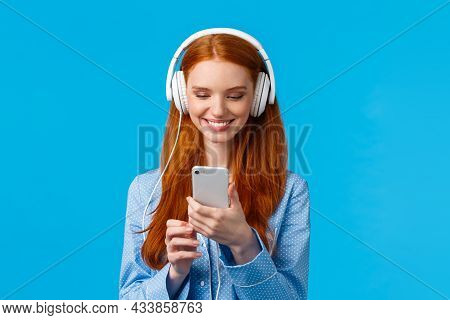 Technology Addication, Lifestyle And Women Concept. Cheerful Good-looking Redhead Woman In Nightwear