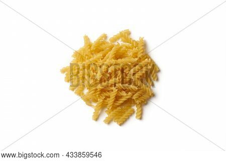 Close-up Of Heap Of Raw Fusilli Pasta Isolated On White Background.