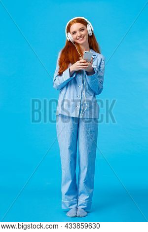 Vertical Full-length Studio Lovely And Romantic Charming Redhead Woman In Nightwear, Listening Music
