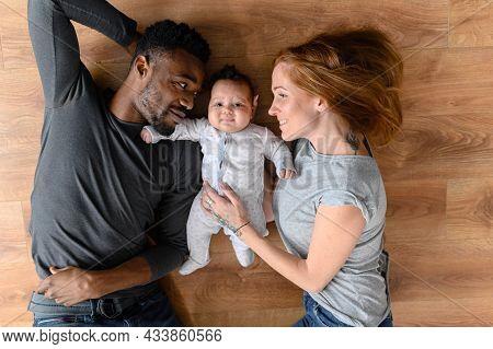 Happy Mixed-race International Family Of Three Lying On The Floor, Happy Black Husband, Caucasian Wi