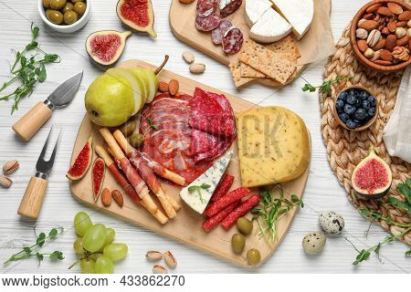 Set Of Different Delicious Appetizers Served On White Wooden Table, Flat Lay