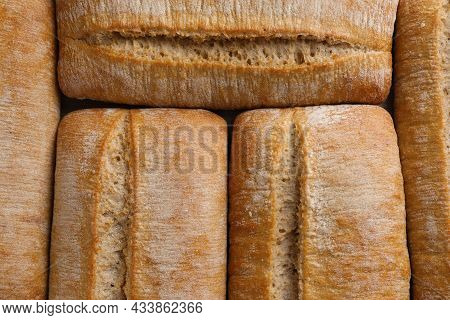 Crispy Ciabattas As Background, Top View. Fresh Bread