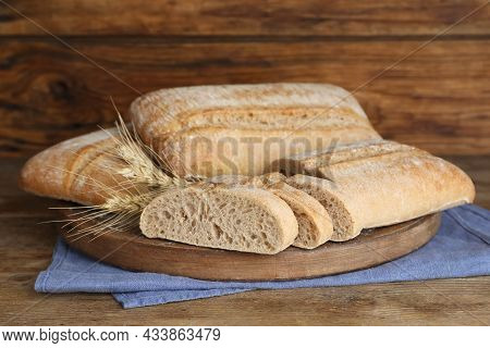 Board With Delicious Ciabattas On Wooden Table