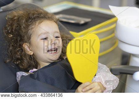 Dental Kid. Examination Treatment Teeth Children. Medical  Checkup Oral Cavity. Child Looking At Cur