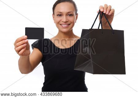 Focus On Blank Plastic Credit Or Discount Card And Black Shopping Bag In The Hands Of Blurred Beauti