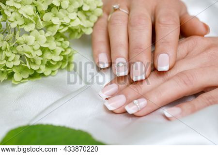 Beautiful French Manicure In Pink And White With Rhinestones For The Bride. Close-up Nails. Wedding