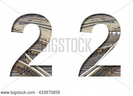 Railway Font. The Number Two, 2 Is Cut Out Of White Paper Against The Background Of Railroad Rails,