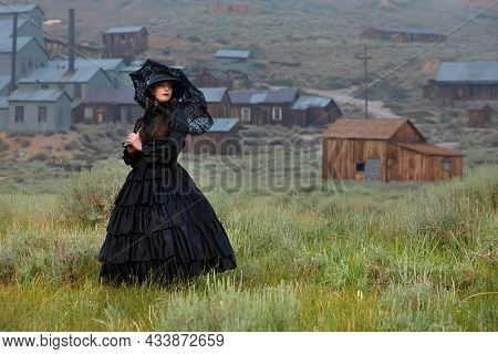 Girl Wearing Vintrage Gown in Bodie Ghost Town California