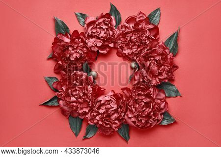 Surreal Peonies Frame On Red Background. Beauty Floral Background. Festive Flowers Concept